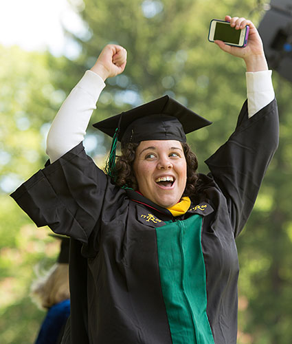Photo: Student celebrating graduation.