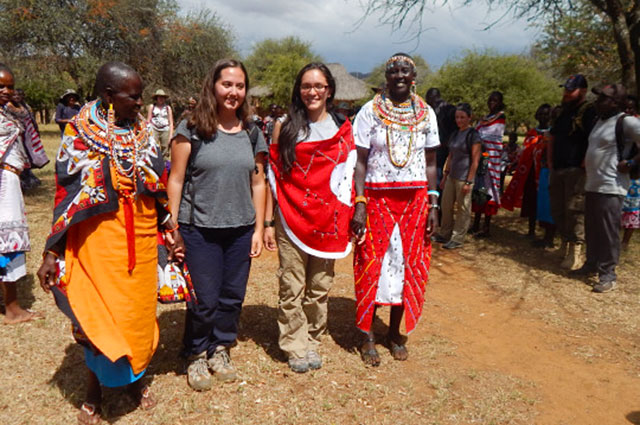 Photo: Two female student with natives in Kenya.